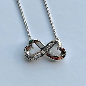 Tiffany white gold infinity necklace with diamonds